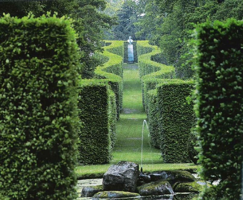 Figures in a landscape  sculpture in the British garden. Figures in a landscape  sculpture in the British garden   The